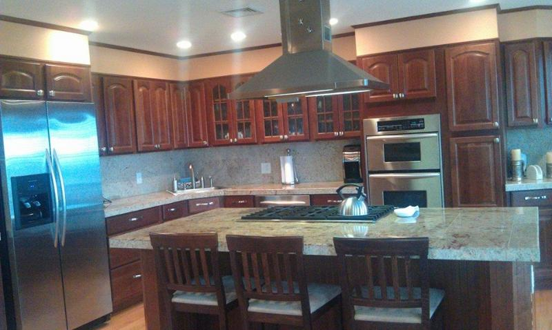Beautiful kitchen with ocean view and a flatscreen tv