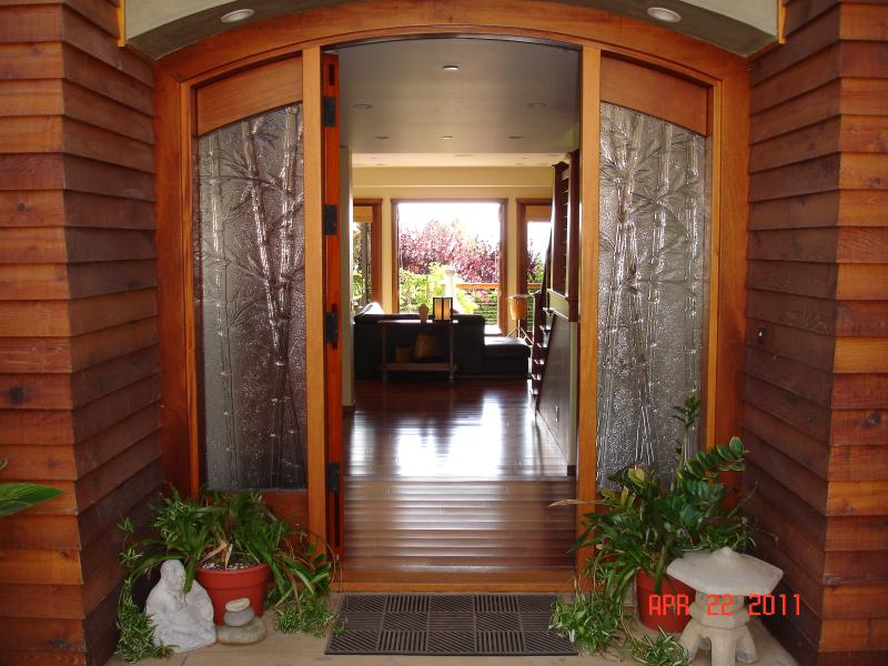 entry (all flooring is custom Brazilian hardwood)