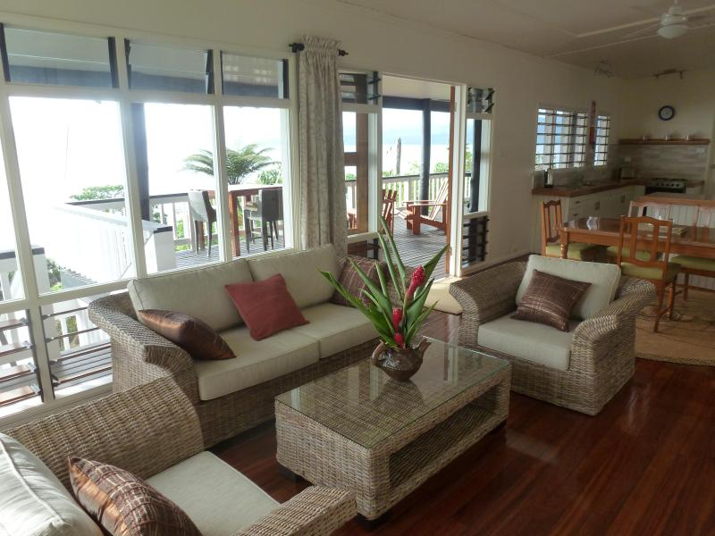 Living, dining room areas & kitchen provide a panoramic view of Savusavu Bay