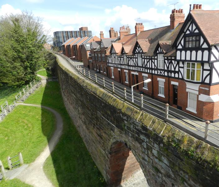 Photo of house taken from Roman city wall showing path down to canal and locks.