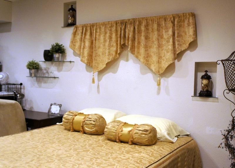 Main living space's has a beautiful and comfortable queen-sized bed.