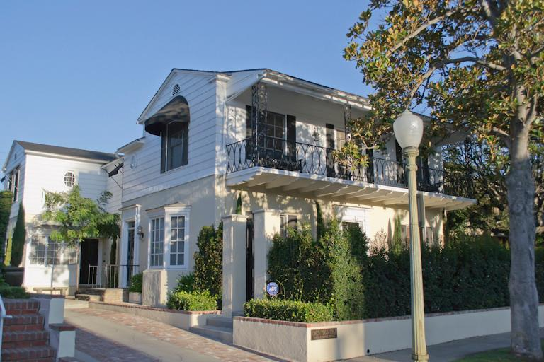 This beautiful triplex was built in 1937 in the Monterey architectural style.