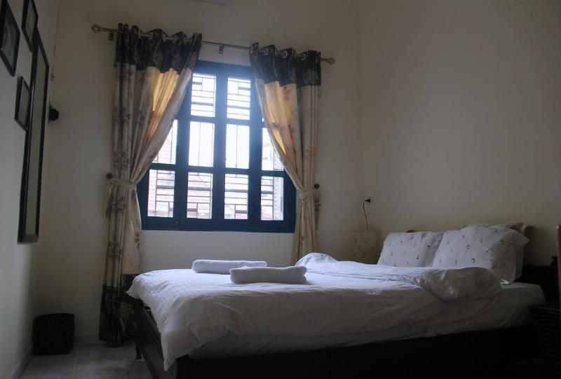 Large bedroom with screened window