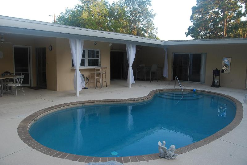Open Pool Area with Eating area and bar