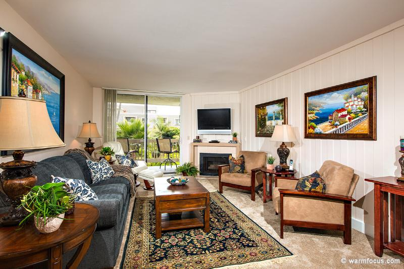 The warm, inviting living room will be an oasis after a fun-filled day at the beach.