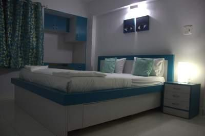 Luxury Room view 1-King size bed with side tables, 32 inch LED TV,Study table,wardrobe and airconditioned