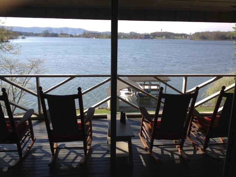 6 rocking chairs on screened porch for wide water view