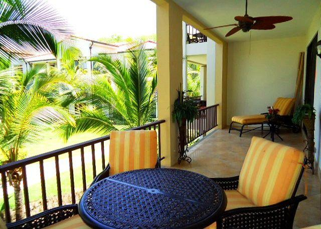 Enjoy the beautifully landscaped grounds and pool from the balcony.