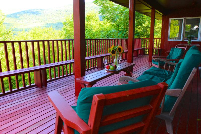 HUGE covered deck with BBQ and stunning mountain views. It feels like a treehouse!
