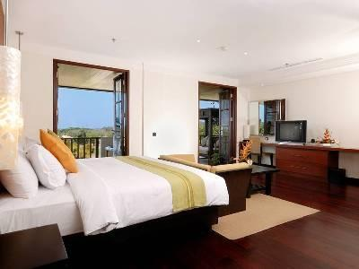 spacious master bedroom with terrace and views of golf course, hills, sea and greenery