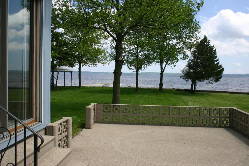 Breathtaking lake views from large patio or from under a shade tree in the lush grass back yard