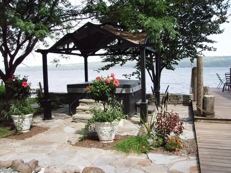 ~Pergola covered, lakeside 6 person HOT TUB on a flagstone patio! (and ROBES, of course!)