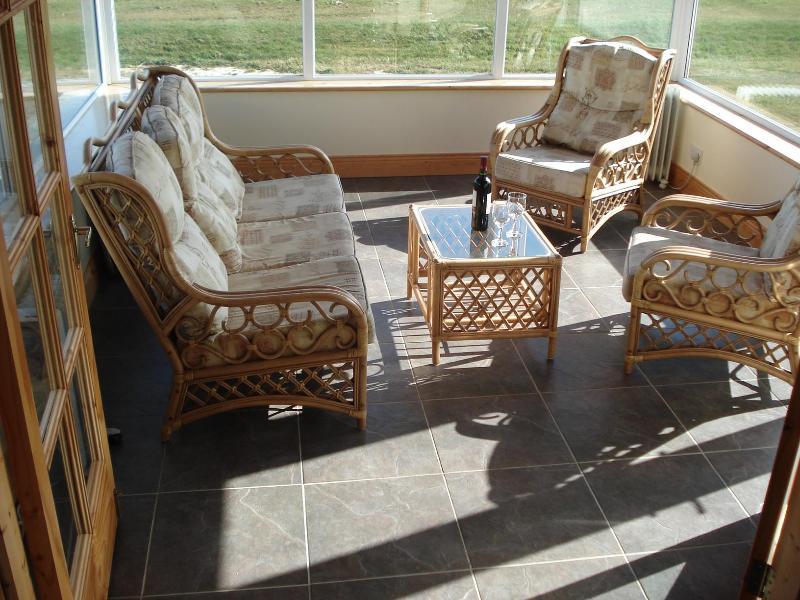 Relax in the beautiful sunroom