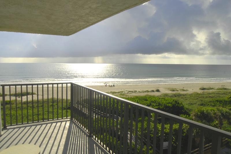 Direct oceanfront views from private wrap-around balcony