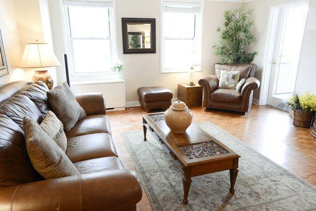Living Space w/ High end furnishings. Big windows let in lots of natural light