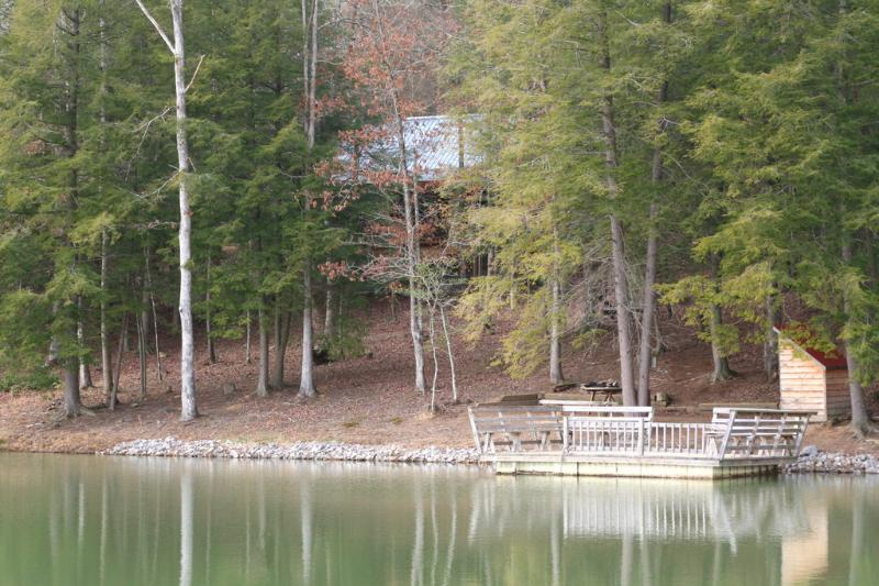 secluded cabin near private lake stocked with bluegill and bass