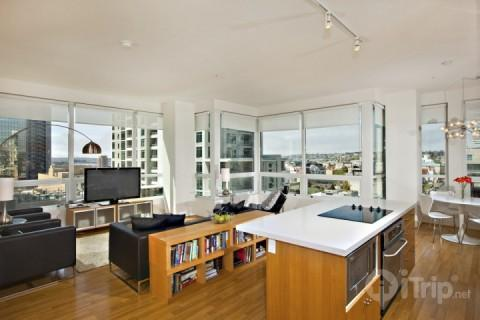 City views from this modern living area