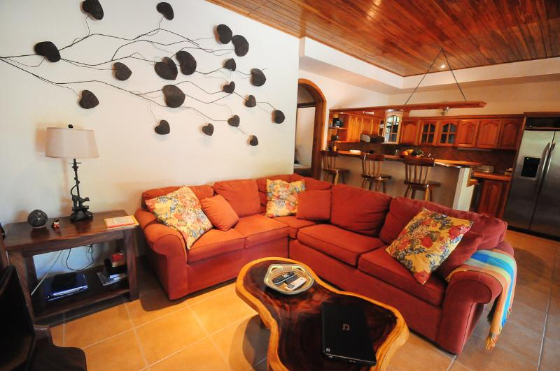 Condo Tortuga's living room, dining & kitchen areas w/10' teak ceiling