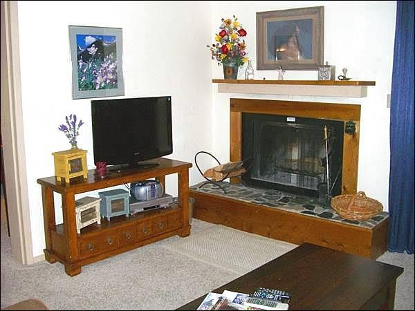 Living Room Includes a Wood-Burning Fireplace and Flat-Screen TV