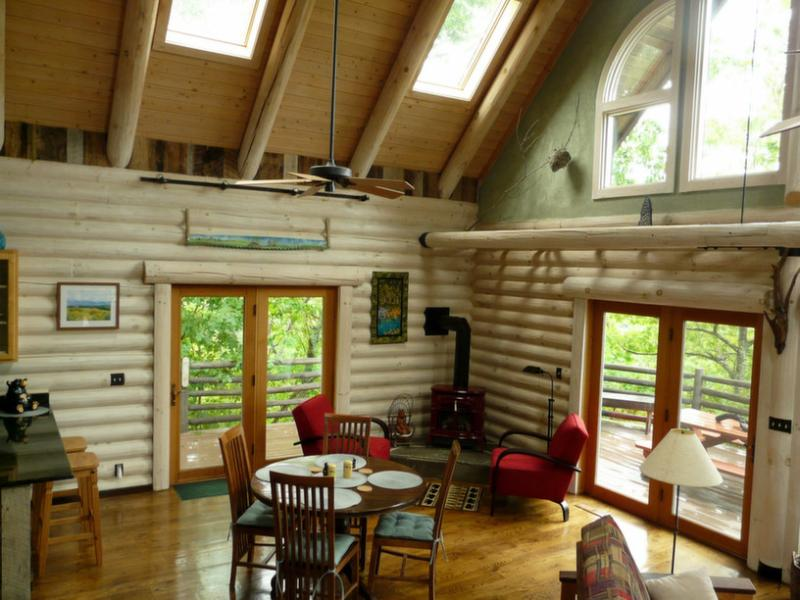 This log cabin is bathed in natural light.