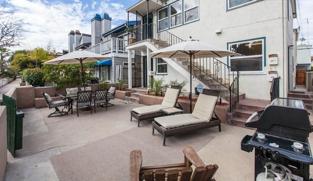 Huge patio w/ high end BBQ, lounge chairs, dining table, fire pit and heat lamp