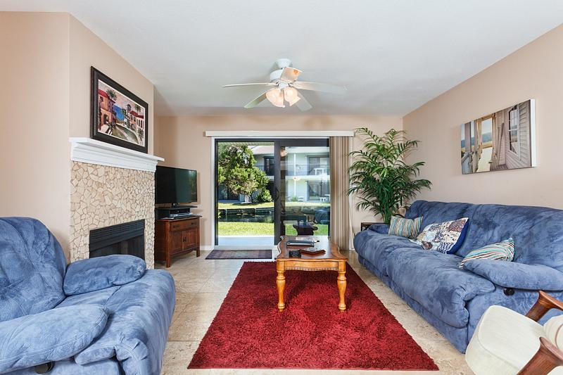 Living room with the most comfortable couch and recliner on the beach! Leads to grass out back.