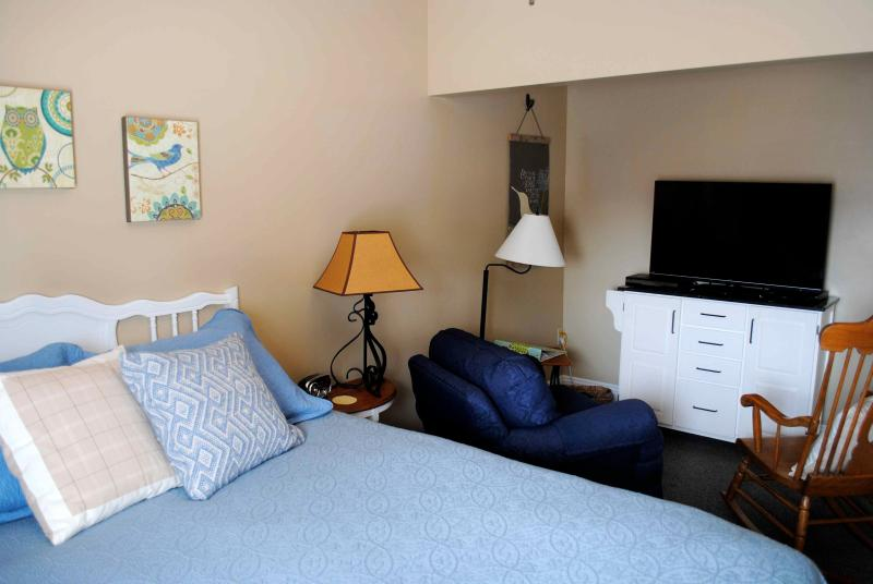 Master Bedroom with queen pillowtop bed, 42' TV, DVD player, oversized chair,