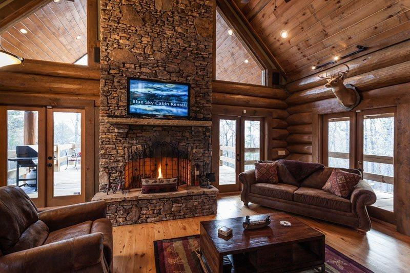 Great Room with a wood burning fireplace and a 42 inch flat screen TV