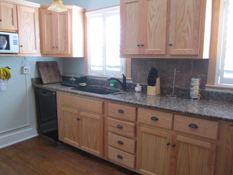 Kitchen with granite counter tops.