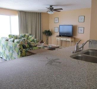 The kitchen is open to the living room and has Gulf views