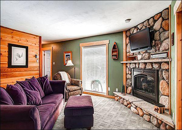 Lovely Living Room Features a Gas Fireplace and Flat Screen Cable TV
