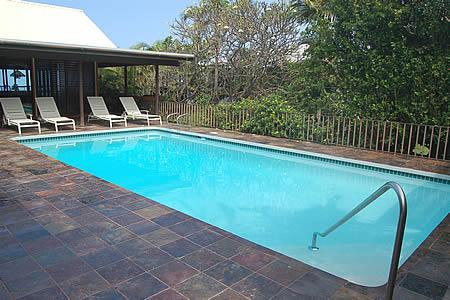 Quiet and private pool  area with hillside, landscape & fence that gives you privacy