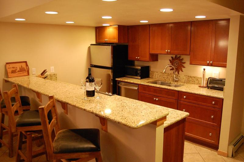 Wonderful kitchen with slab granite and SS appliances