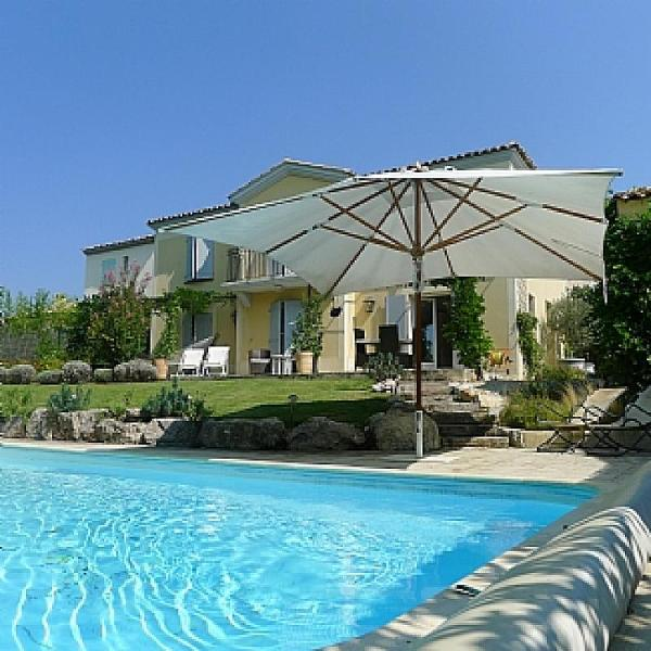 The house has a wonderful pool and is placed with great surroundings. The seating area beside pool h