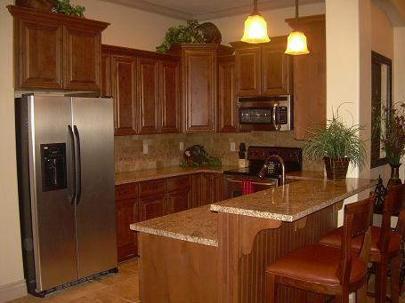 Beautiful kitchen with granite counter tops and lovely bar area