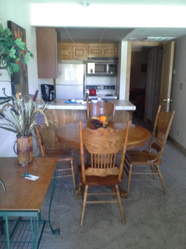 Kitchen and dining area. Kitchen is fully stocked with all your cooking needs