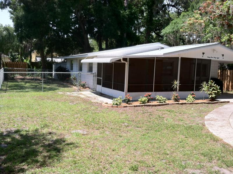 Front of house - dog run and fenced