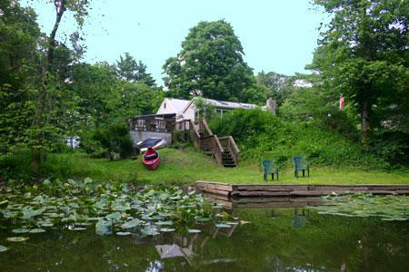 boat launce from backyard at esopus creek cottage - view towards back of house, deck, yard