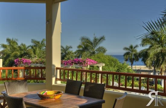 350 sq foot terrace overlooking the pool with and ocean view