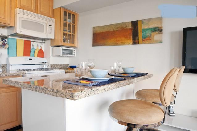 Newly remodeled kitchen with granite breakfast bar and seating for two