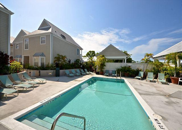 This Pool is The Duval Square Properties' Shared Pool.  The Area Has Comfortable Loungers For Your Relaxation Along With A Covered Deck Area With Additional Seating