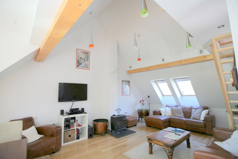 Large but cozy sitting room with comfortable leather sofas.  Big TV, WiFi, Surround sound ...