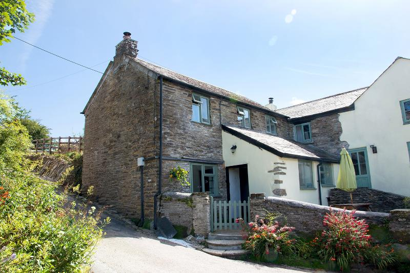 Mill Cottage with parking space in view across from cottage & enclosed patio.