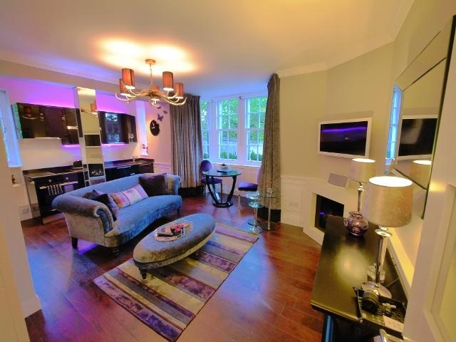 Luxurious living area with fully fitted kitchen