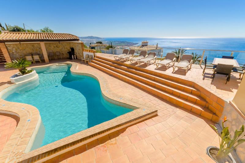 Free form heated pool with sun terrace