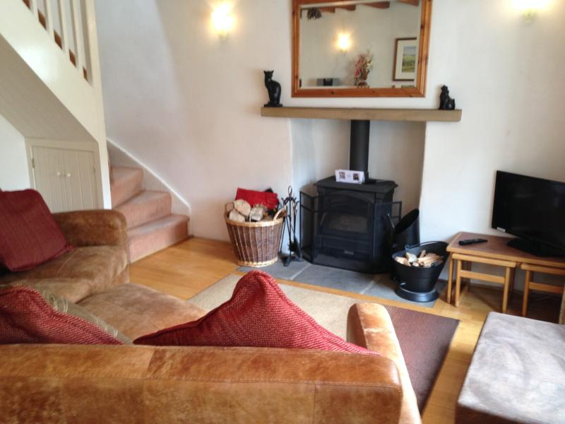 Welcome to The Bolthole - imagine sitting on this lovely sofa in front of the log burner!