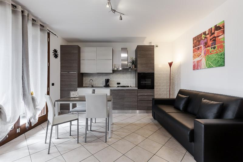 Livingroom & kitchen with a comfortable double sofa bed and a terrace