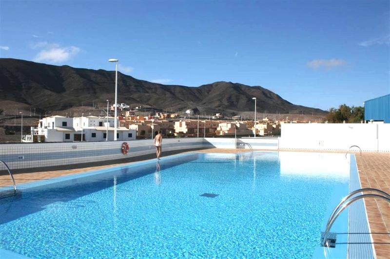 25 metre pool with sea and mountains in background