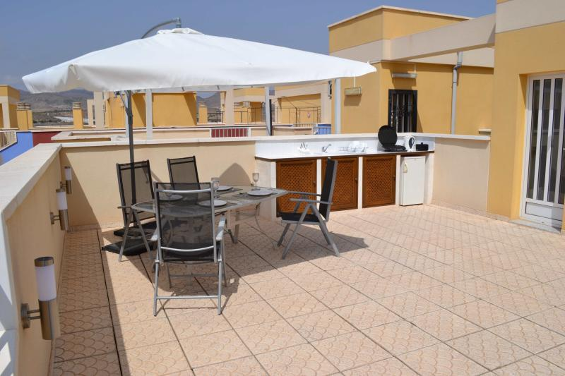 Your Vast Private Roof Terrace boasting an Outdoor Kitchen, sun loungers with sea and mountain views
