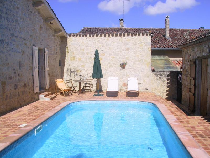 French windows from both cottages open onto the sun trap courtyard with salt-water pool